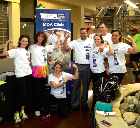Making a muscle with the Gold's Gym Team for the MDA Zumbathon