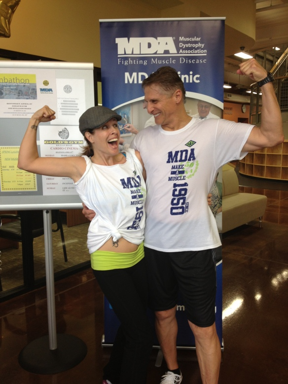 Shannon & David Making a Muscle for the MDA at our Zumbathon